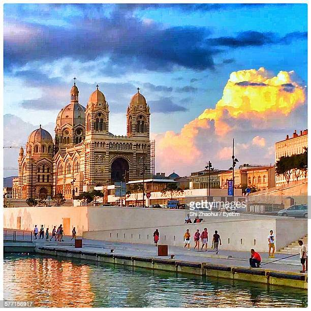 people walking on pedestrian walkway by marseille cathedral against sky - marselha - fotografias e filmes do acervo