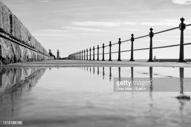 people walking on pier against sky - sunderland stock pictures, royalty-free photos & images