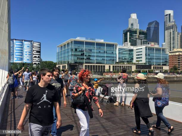 People walking on Puente de la Mujer, Buenos Aires, Argentina