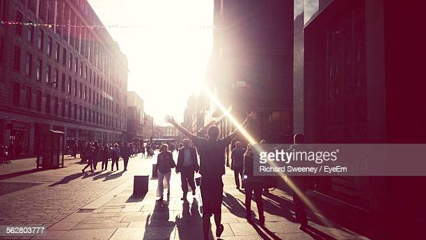 people walking on road along buildings - glasgow stock pictures, royalty-free photos & images