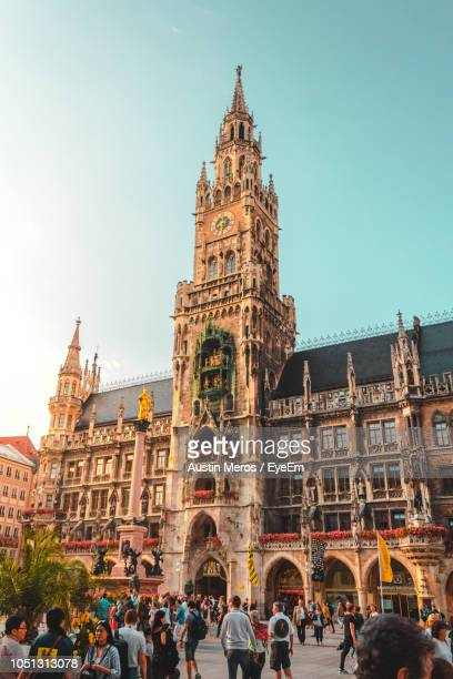 people walking on street against church - munich stock pictures, royalty-free photos & images