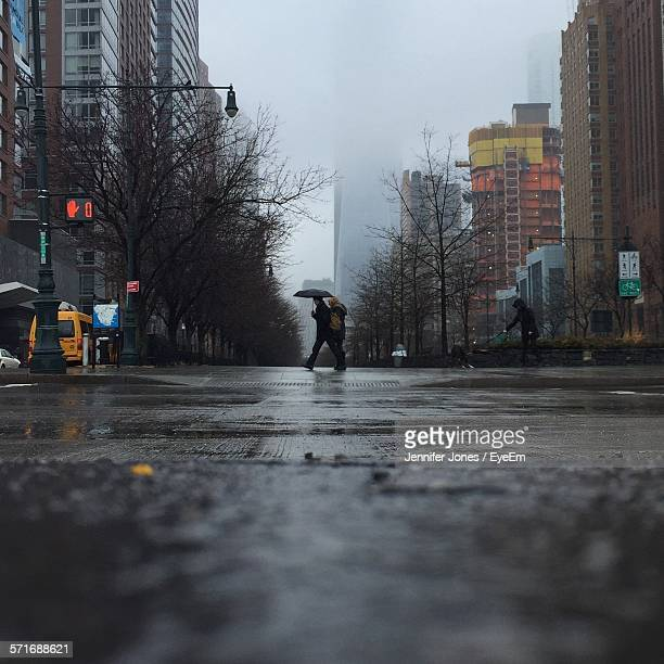 People Walking On Street On Rainy Day