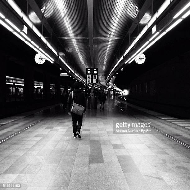 people walking on subway platform - square composition stock pictures, royalty-free photos & images