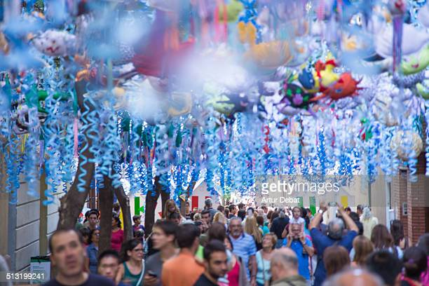 People walking on the Barcelona´s decorated street