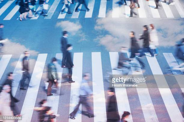 people walking on the city with clouds, multi-layer image - 問題 ストックフォトと画像