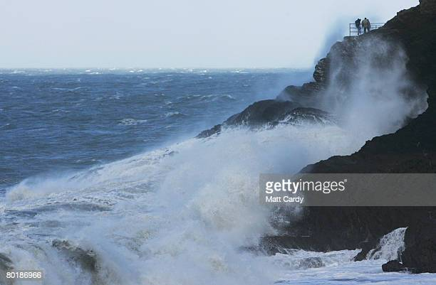 People walking on the cliffs are hit by waves on the on March 10 2008 in Ilfracombe United Kingdom Weather forecasters are saying parts of the UK are...