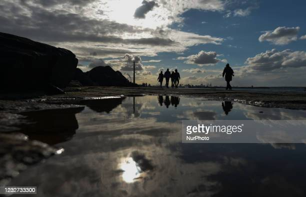 People walking on the Great South Wall in Dublin during the final days of the COVID-19 lockdown. On Thursday, May 6 in Dublin, Ireland.