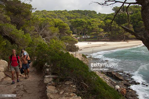 People walking on the historic bridleway Cami de Cavalls next to the beach of Cala Macarella on October 09, 2010 in Menorca, Spain. Menorca is the...