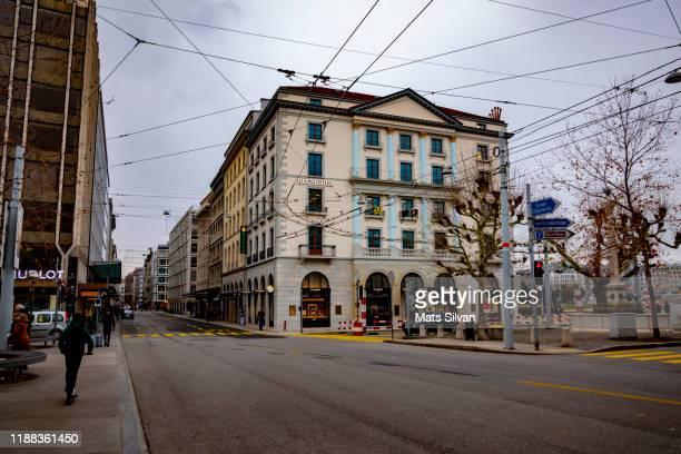 people walking on the main shopping street in geneva, switzerland. - vanishing spray stock pictures, royalty-free photos & images