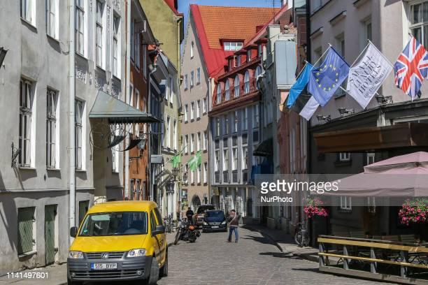People walking on the Old Town street are seen in Tallinn Estonia on 30 April 2019