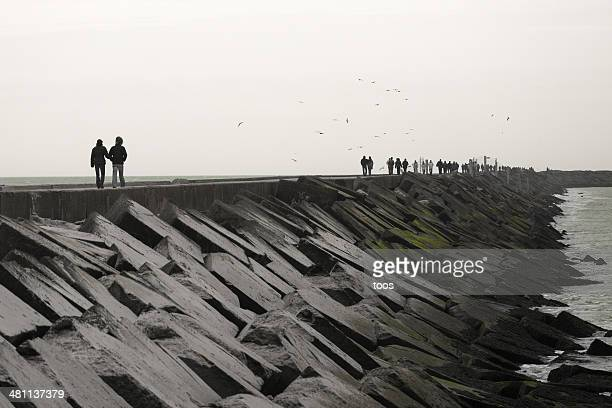 people walking on the pier of ijmuiden, north sea - noord holland stockfoto's en -beelden