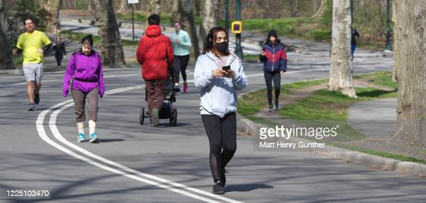 people walking on the street in central park, nyc - henry street stock pictures, royalty-free photos & images