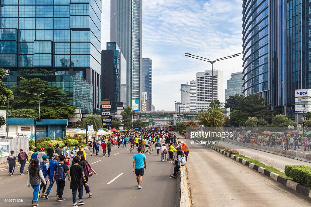 People walking on the streets of Jakarta business district : Stock Photo