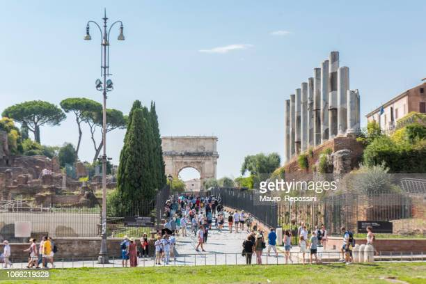 People walking on the Via Sacra (Sacred Road) in the Roman Forum at Rome city, Italy.