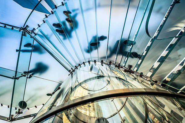 Business People on Glass Staircase Modern Architecture