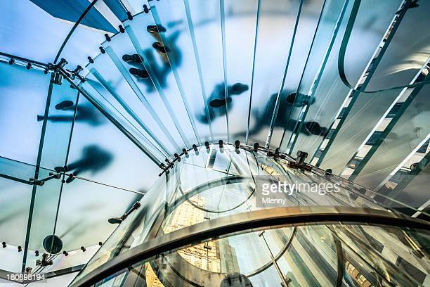 People walking on transparent glass staircase