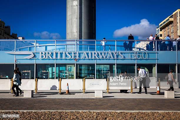 People walking outside British Airways i360 tower in Brighton, UK