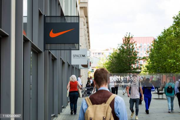 people walking outside nike town store at king's cross, london, uk - nike designer label stock pictures, royalty-free photos & images