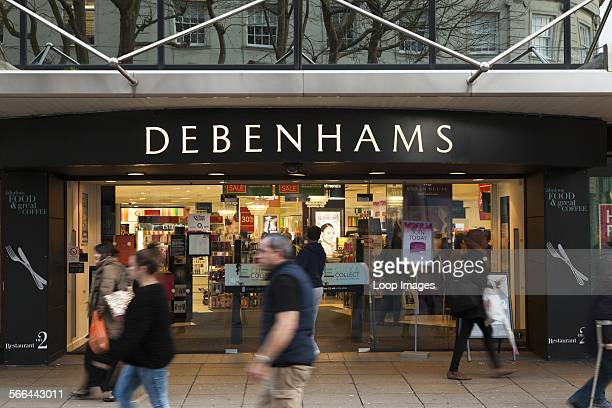 People walking past Debenhams store entrance.