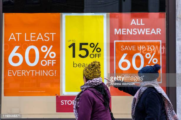 People walking past the sale signs outside the Folkestone Debenhams store in the final few days of the Everything Must Go sale before closing down on...