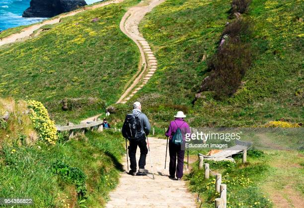 people walking the southwest coast path in Cornwall England Britain uk