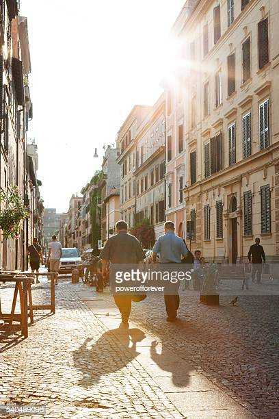 People walking the streets of downtown Rome, Italy