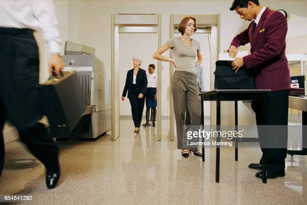 people walking through airport security - security check fotografías e imágenes de stock