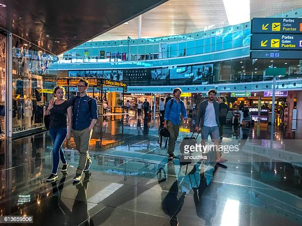 People walking through Barcelona Airport, Spain