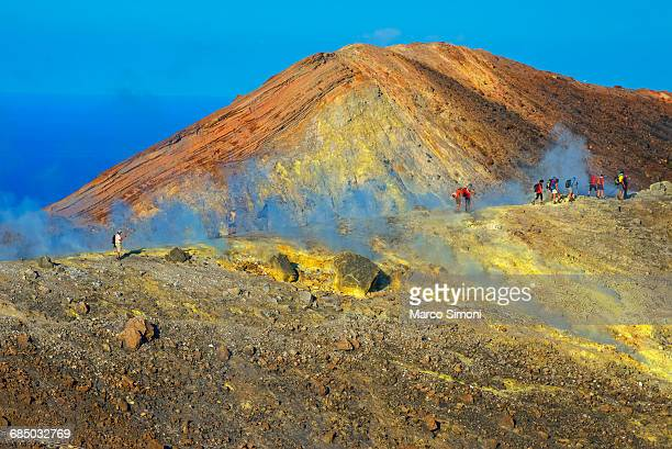 People walking through fumaroles on Volcano Gran crater rim, Vulcano Island, Aeolian Islands, UNESCO World Heritage Site, Sicily, Italy, Mediterranean, Europe