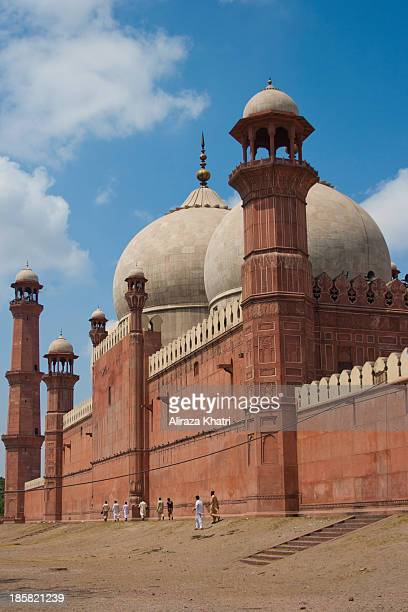 CONTENT] People walking through the back of Badshahi Mosque at a sunny day Lahore Pakistan