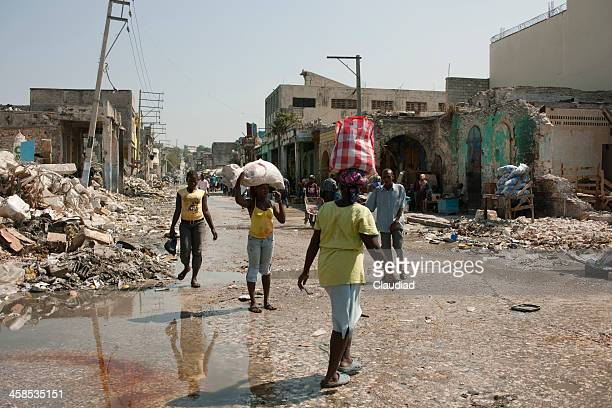 People walking through the destroyed Haiti