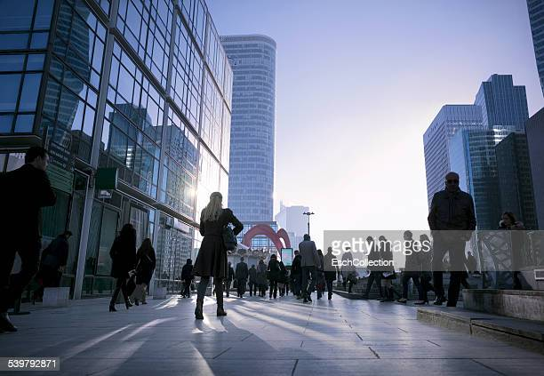 people walking to work at business district - la défense stock pictures, royalty-free photos & images