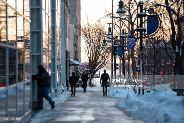 People walking to work in the early morning on South Pinckney Street in downtown Madison Wis as extreme temperatures hit the region Jan 29 2019