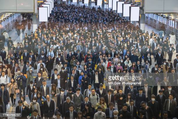 people walking to work,large group of business people,crowds of commuters and transportation concept - japan commuters ストックフォトと画像