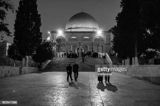 People walking towards Dome of Rock after fajr prayer in Masjidil Aqsa of Baitulmuqadis