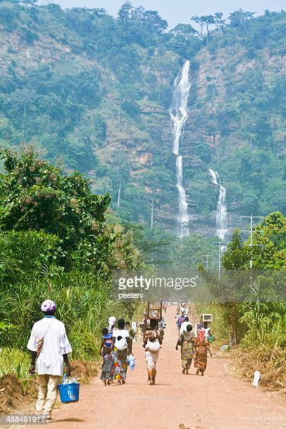people walking towards kpalime waterfalls. - togo stock pictures, royalty-free photos & images