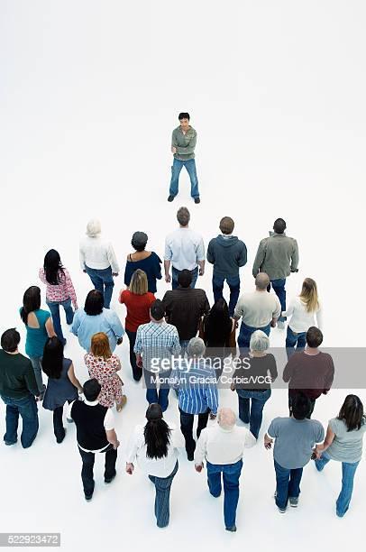 People walking towards one man