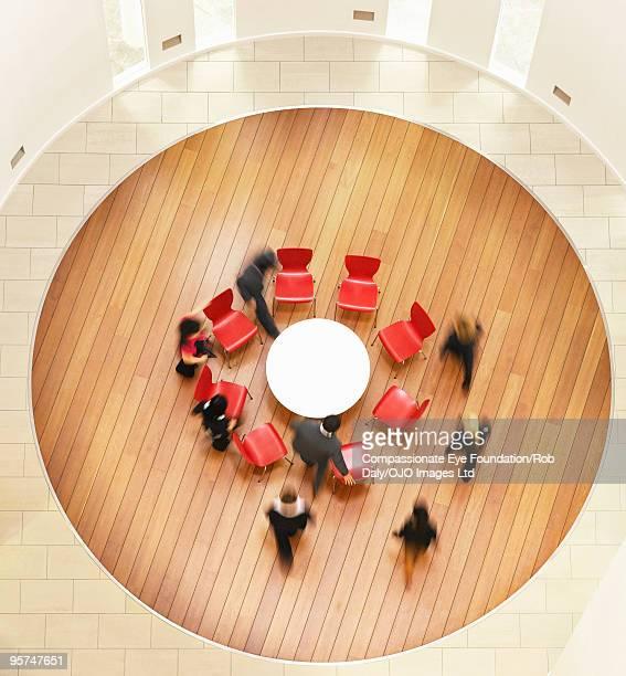 People walking towards round table