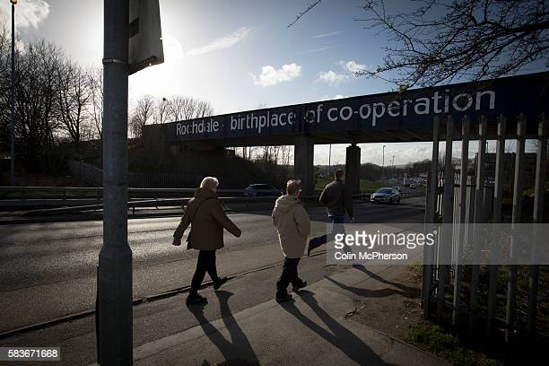 People walking under a railway bridge in the town of Rochdale in Greater Manchester The town the birthplace of the Cooperative movement and was known...