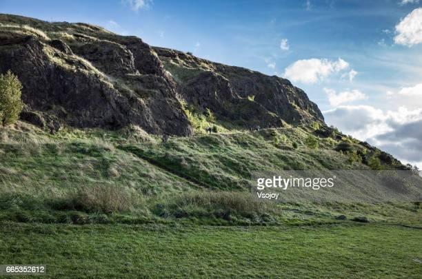 People walking up the Salisbury Crags, Holyrood Park, Edinburgh