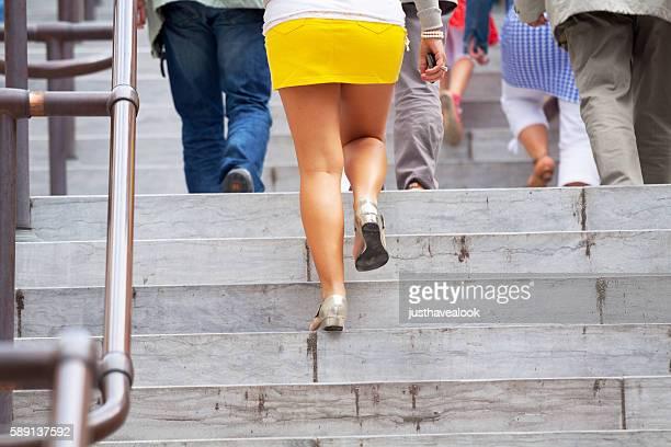 People walking upstairs at summertime
