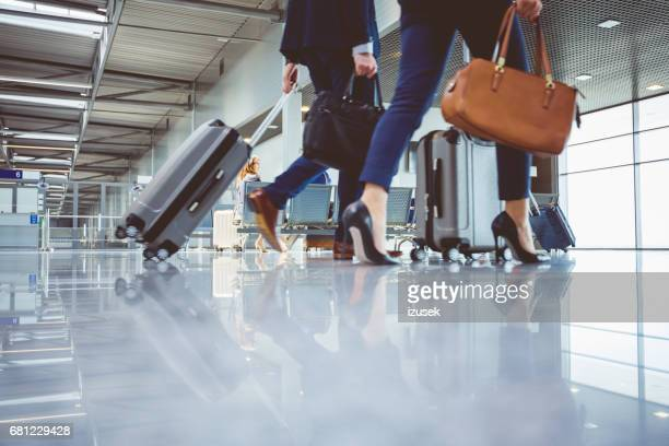 People walking with baggage in airport terminal