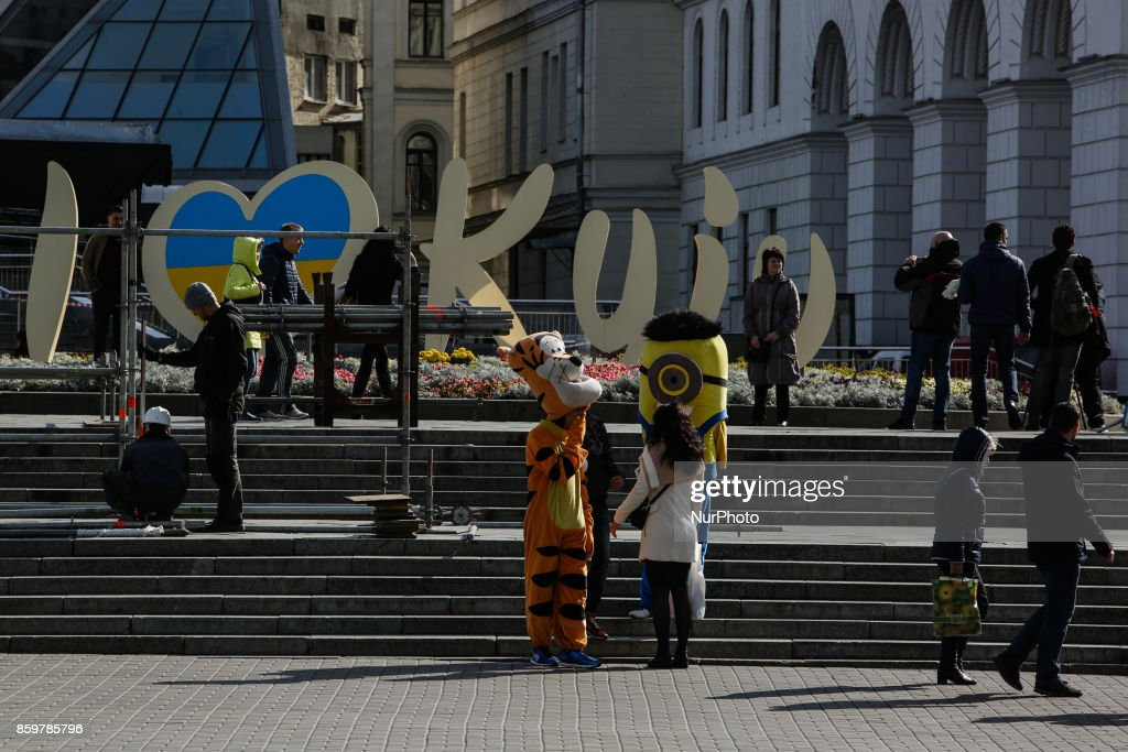 """People walks at Independence square near the sign """"I love Kyiv"""" in Kyiv, Ukraine, October 10, 2017."""