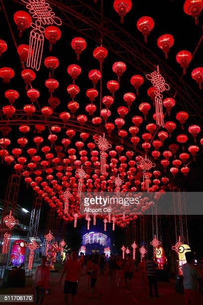 People walks below Chinese lanterns at the Fo Guang Shan Ding Zen Temple to celebrate the Lantern Festival on the last day of Chinese Lunar New Year...