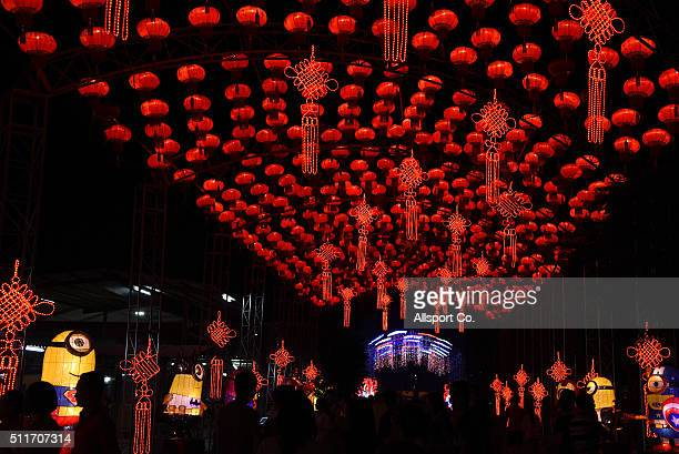 People walks below Chinese lanterns at the Fo Guang Shan Dong Zen Temple to celebrate the Lantern Festival on the last day of Chinese Lunar New Year...