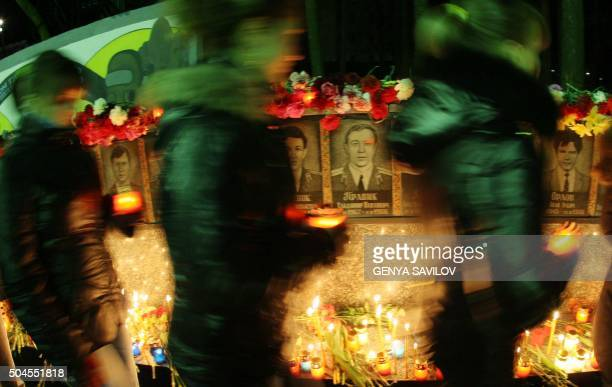 People walks holding candles in front of a memorial for Chernobyl victims in Slavutich 200 km north of capital Kiev on April 26 2010 Ukraine marked...