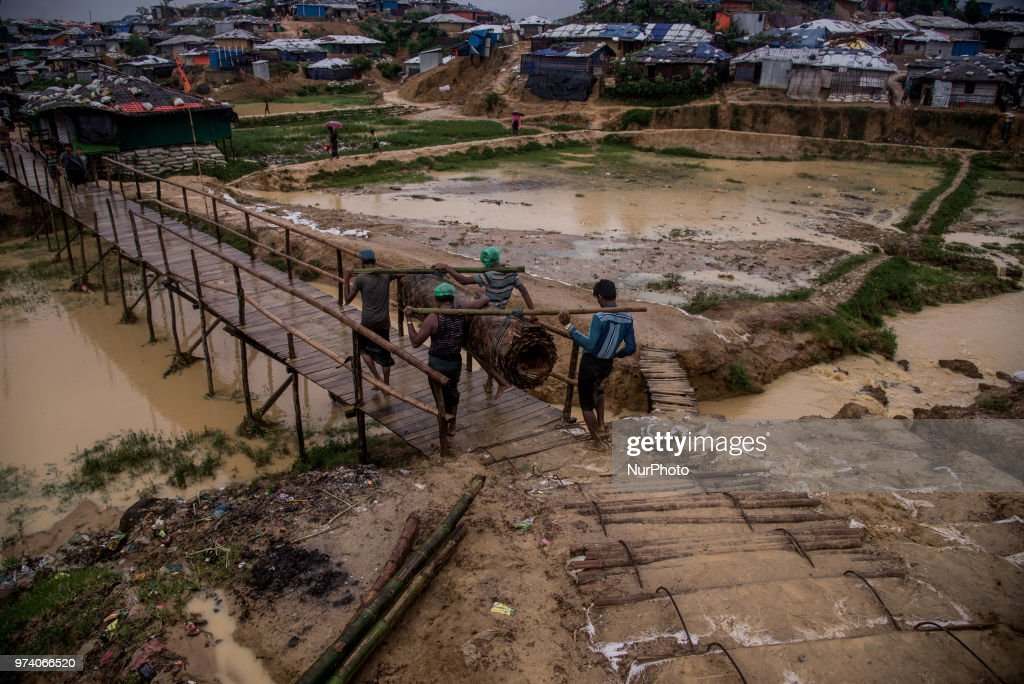 People walks inside the Kutupalong makeshift shelter in Coxs Bazar, Bangladesh on June 13, 2018. Around one million Rohingya Refugees has taken shelter on the hills of makeshift shelter in the border side area Cox's Bazar. As the monsoon season has started, the livelihood of rohingya becomes tough even the season becomes threaten for their lives on the hills.