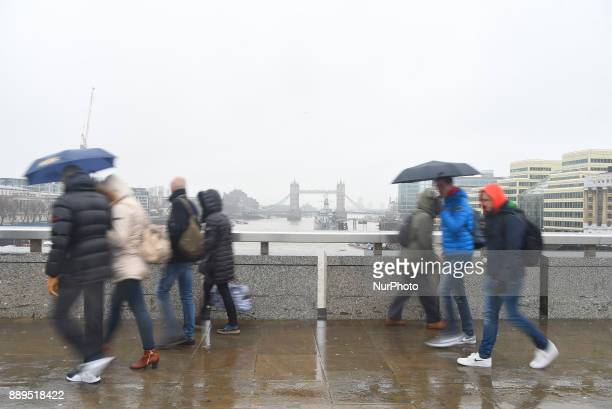 People walks on London Bridge under a snow fall London on December 10 2017 According to the BBC the deepest snowfall in the UK has been in...