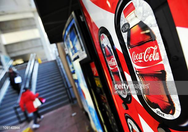 People walks past Coca Cola vending machines in Arlington Virgina on February 15 2011 An edgy public radio show has revealed what it purports to be...