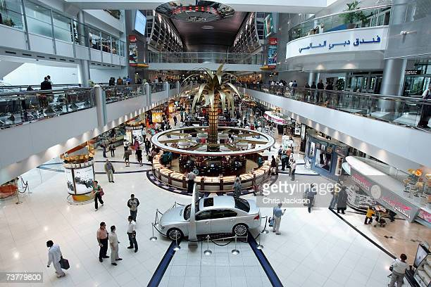 People wander around Dubai Duty Free at Dubai Airport on April 3 2007 in Dubai United Arab Emirates Commerce and Industry is currently thriving in...